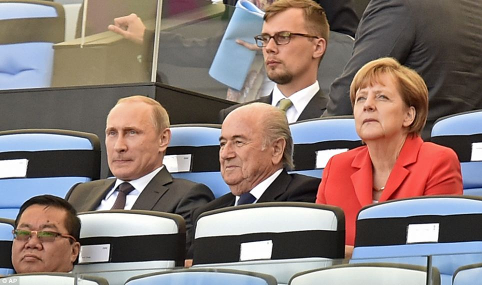 Faces in the crowd: Russia's President Vladimir Putin, left, FIFA President Sepp Blatter, center, and Germany's Chancellor Angela Merkel, right, watch the closing ceremony