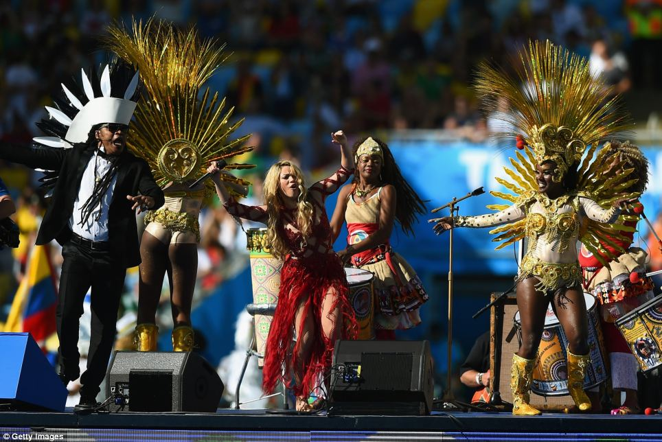 Bringing glamour to the proceedings: Columbian singer Shakira wowed fans as she joined forces with Carlinhos Brown (left)