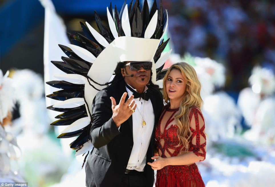 Song and dance: Carlinhos Brown wore a distinctive black and white headdress as he performed with Shakira