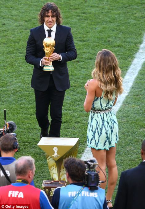In place: Puyol and model Gisele Bundchen present the World Cup trophy prior to the match