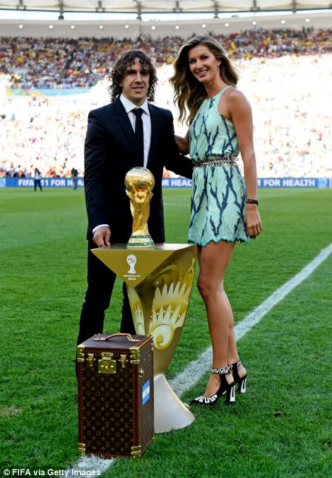 Former Spanish international Carles Puyol (L) and model Gisele Bundchen present the World Cup