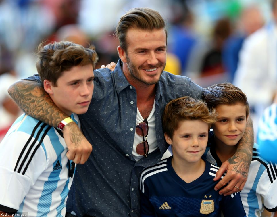 Family outing: David Beckham and his three sons Brooklyn, Cruz and Romeo were all in attendance - with the boys all wearing Argentina kits