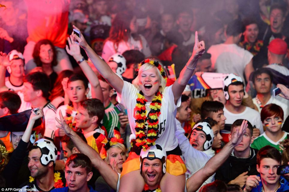 Elated: After nervously seeing out the final moments of the game, the German team and their fans burst into wild celebrations as the final whistle blew