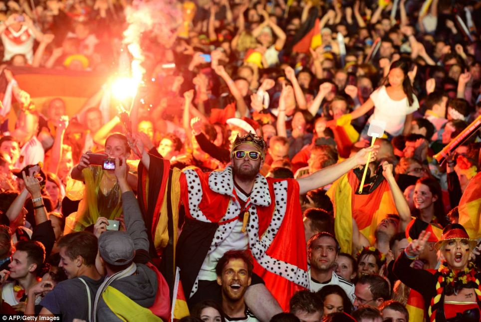 On a wing and a flare: German fans celebrate as the final whistle blows in the Maracana stadium
