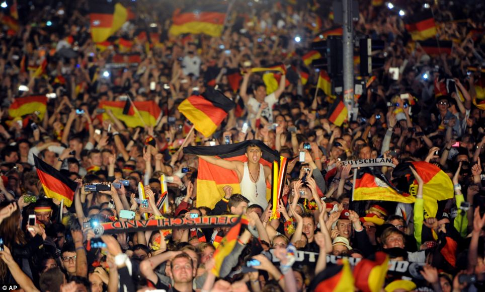 Cause for celebration: Fans back home in Berlin were just as excited to see their team's win as the supporters who made it to Brazil were