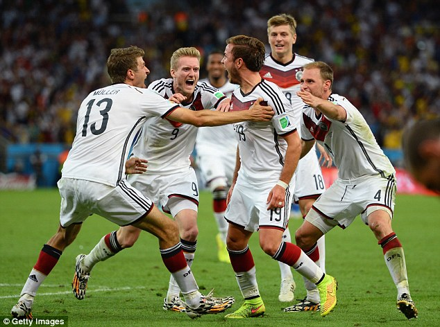 Mob rule: Gotze (No 19) is surrounding by his ecstatic team-mates after scoring the winning goal in the final