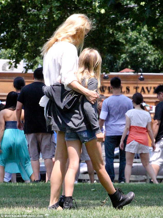 Thick as thieves: The pair's close bond was visible to all as they strolled through the park with their arms sweetly wrapped around one another, chatting away effortlessly