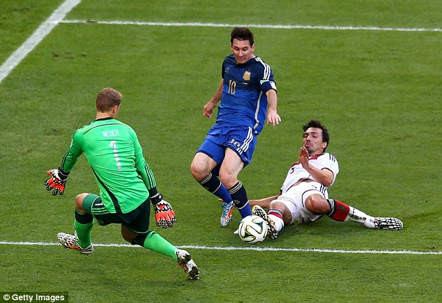 One on one: Lionel Messi closes in on Manuel Neuer's (L) goal as he tries to break the first-half deadlock