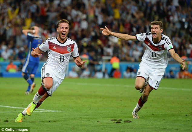 German engineering: Mario Gotze and Thomas Muller wheel away after bringing the World Cup to Europe