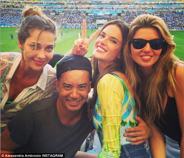 Brazilian beauty: Alessandra Ambrosion flashed a peace sign in a photo from the stadium shared on Instagram