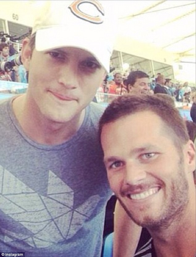Famous faces: Ashton Kutcher and Tom Brady hung out together at the stadium