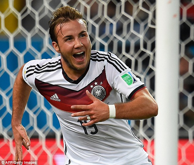 Winning goal: The famous and non-famous watched Germany forward Mario Goetze score the winning goal during the second half of extra-time