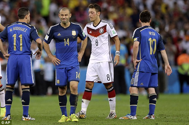 Pain: Javier Mascherano (second left) believes Argentina's players will never get over their loss to Germany