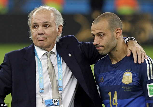 Down and out: Mascherano (right) and Argentina coach Alejandro Sabella (left) look dejected after the whsitle