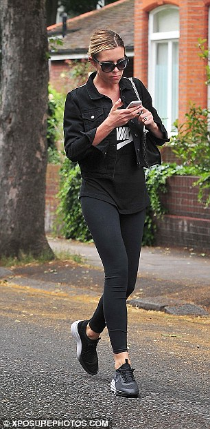 Back in business: Abbey on her way to the gym in London looking serious about matters on her mind