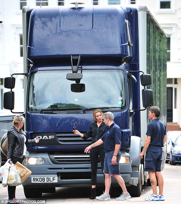 Working things out: Abbey looked as if she was working with the lorry drivers in her black overalls