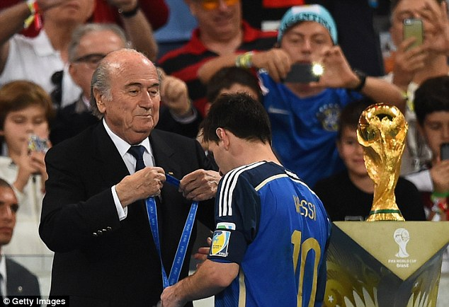 Didn't deserve it: Blatter hands Lionel Messi his medal before he was awarded the Golden Ball gong