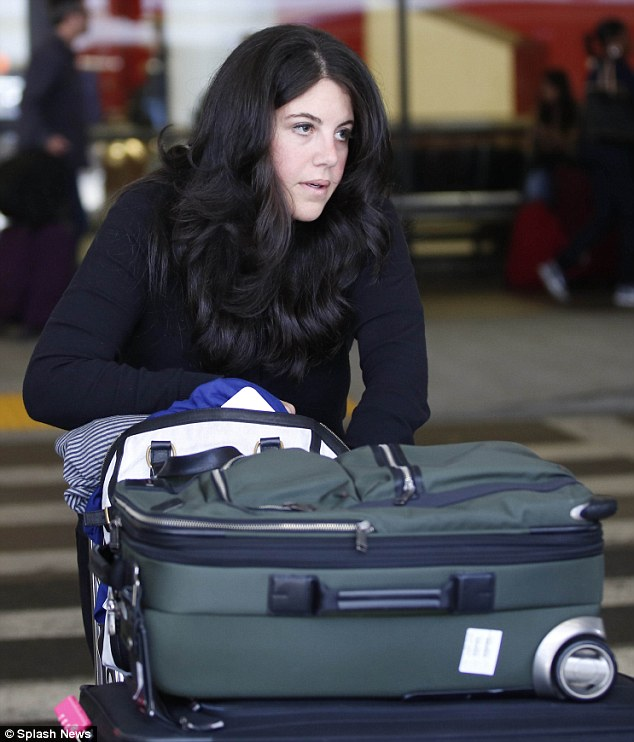 Sight for sore eyes: Monica Lewinsky looks tired after arriving in Los Angeles following her overseas jaunt