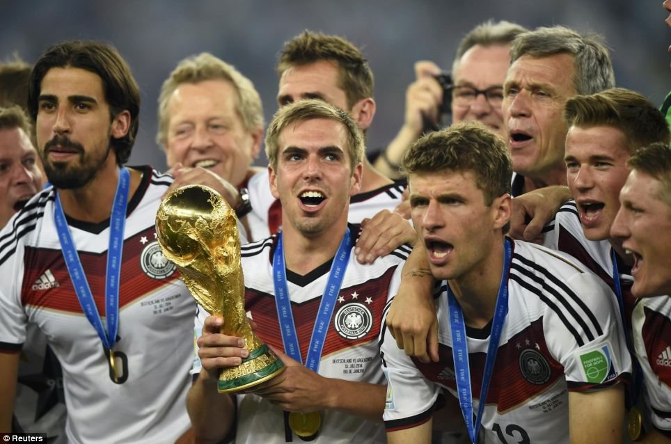 Cheers for heroes: The Germans link arms as they celebrate with their trophy