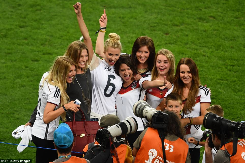 Wags united: The wives and girlfriends of the German squad enjoy their moment in the spotlight after cheering on their partners in Brazil