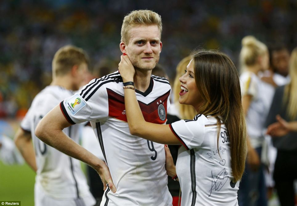 Proud moment: Andre Schuerrle is congratulated by girlfriend Montana Yorke, who wore a shirt he had signed with the message 'I love you'