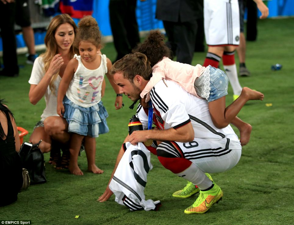 Playing around: Götze seems happy to become something of a human climbing from for one of Boateng's young daughters