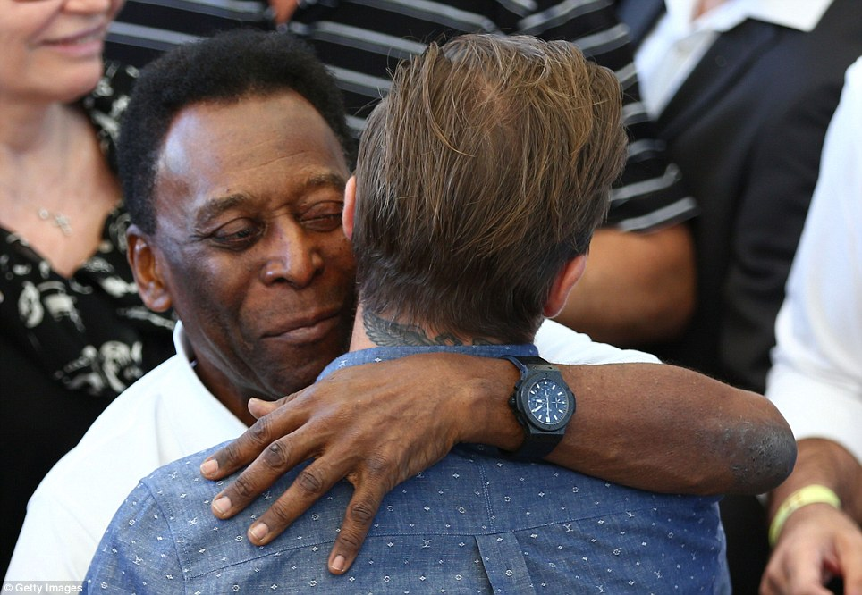 Embrace: Pele hugs former England captain David Beckham as the pair prepare to take their seats in the stands to watch the World Cup Final
