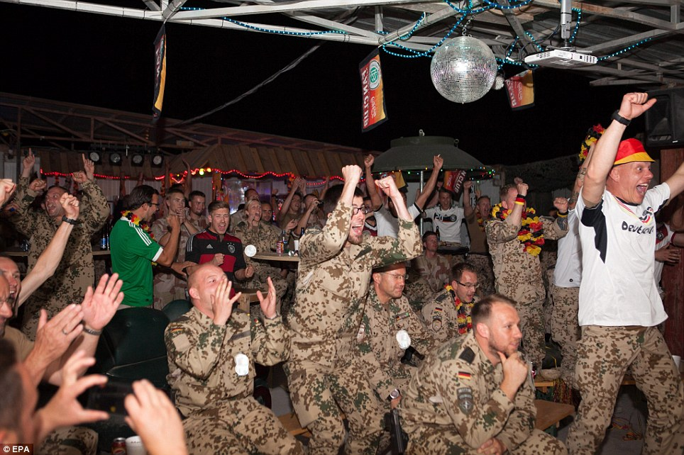 Courage: German soldiers at Camp Marmul in Mazar-e-shari, Afghanistan, leap into the air with joy as the final whistle blows in the 2014 World Cup final