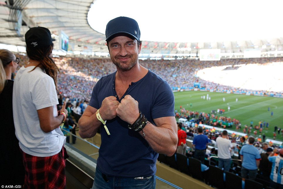 Tough luck Argentina! Scottish actor Gerard Butler strikes a boxing pose while watching the World Cup Final in Rio's Maracana stadium. He spent much of the game sitting alongside Barbadian pop star Rihanna