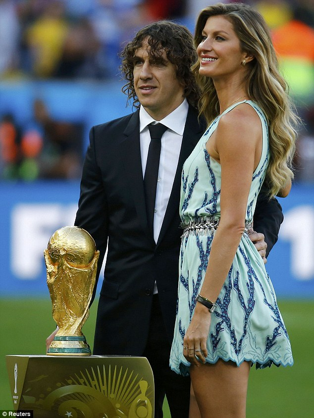 Trophy people: Retired Spanish national team player Carles Puyol and Gisele Bundchen unveiled the trophy before the championship match