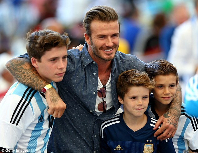 Good times: David Beckham attended with sons Brooklyn, Romeo and Cruz