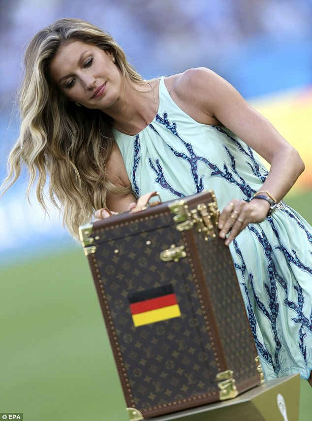 Chic champions: Gisele checked to see if the specially made Louis Vuitton case was ready to transport the trophy