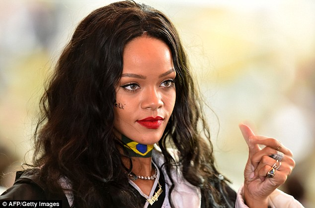 A show of support: Football fan Rihanna had the name of Brazilian great Pele painted onto her right cheek