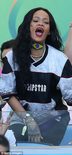 Cheerleader: The pop star really got into the game shouting loudly, despite her native Barbados not playing
