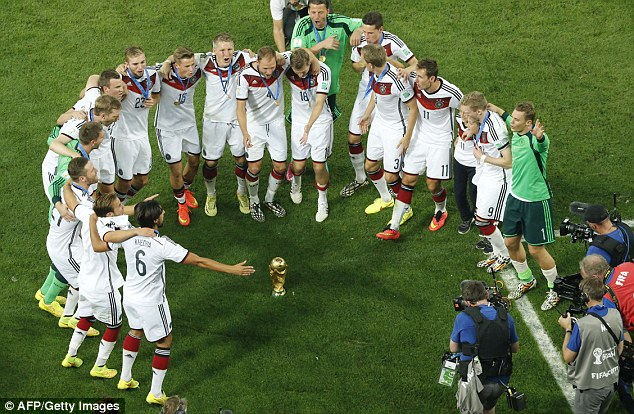 World champions: Germany's players celebrated on the pitch after winning the FIFA World Cup