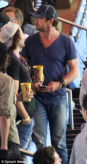 In the mix: Scottish actor Gerard Butler was in the crowd at the Maracana on Sunday evening