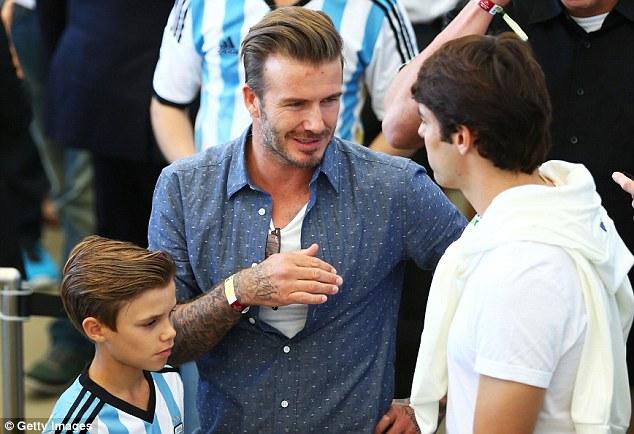 Old pals: Beckham enjoys a chat with former Real Madrid teammate Kaka
