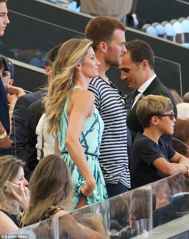 Different football: After her official duties were dealt with the model enjoyed the game with her quarterback husband