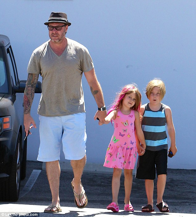 Action daddy: When the family arrived Dean led the two children in a chain of linked hands