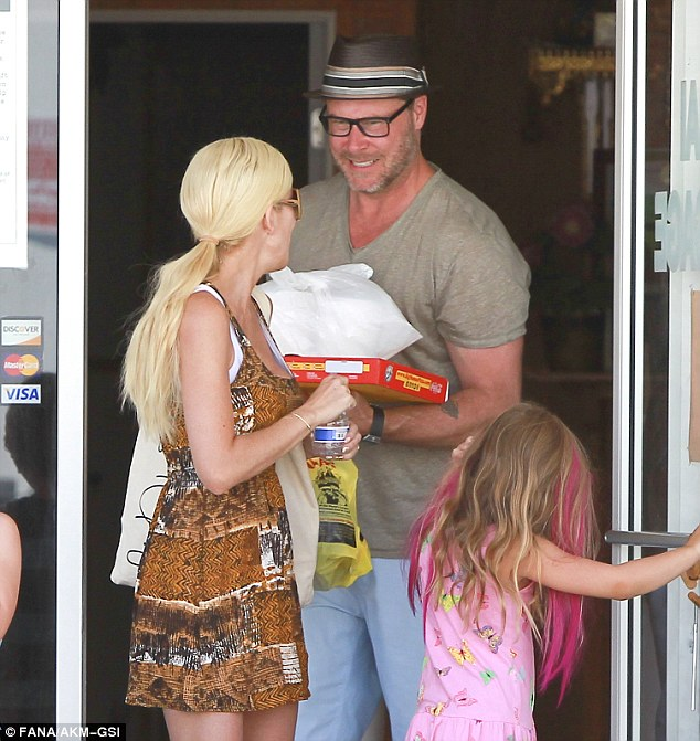 Happy family: Dean and Tori shared a sweet moment as they exited the massage parlour
