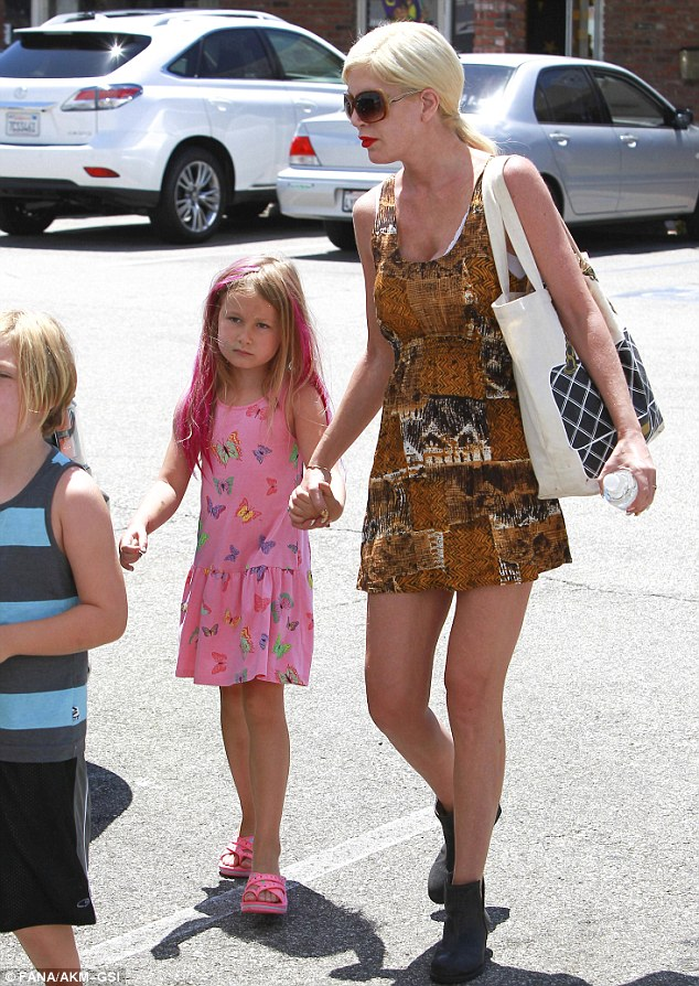 Hold my hand: The 42-year-old walked her children back to the car