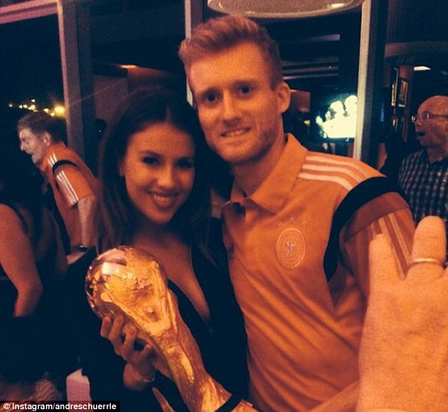 Happy couple: Andre Schurrle celebrates with the World Cup and his girlfriend