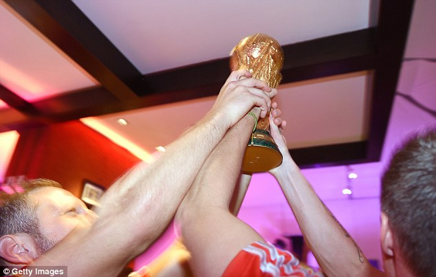 Lift it up: Germany players lift the World Cup trophy as they celebrate after the match