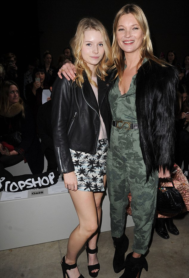 Showing her the ropes: Lottie is the daughter of Kate's father Peter and his second wife Inger. Here, Kate shows Lottie a taste of her world on the front row of Topshop Unique's AW14 show