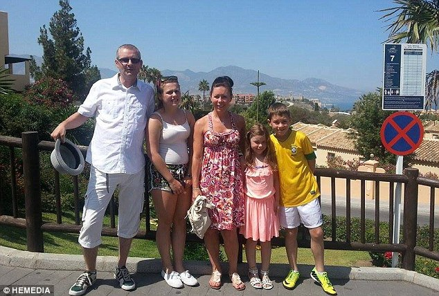 Holiday hell: Paul and Valerie Clark were with their three children, Caitlin, 16, Logan, 11, and eight-year-old Isla when they were forced to flee the Spanish holiday resort