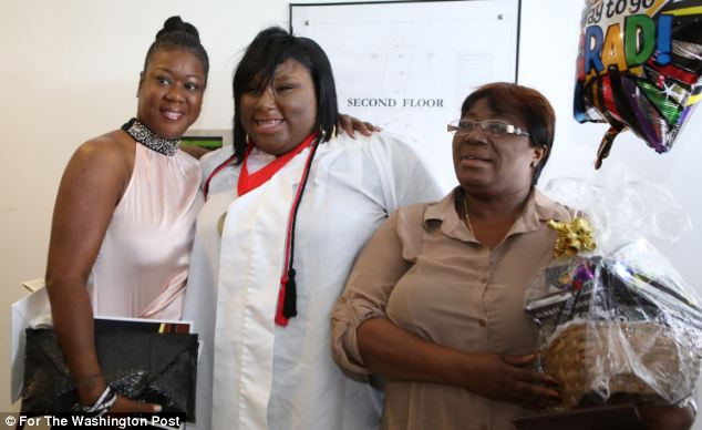 Jeantel, 20, poses with Sybrina Fulton following her graduation from the Academy for Community Education (ACE) in Miami, Florida as her mother, Marie Eugene, looks on