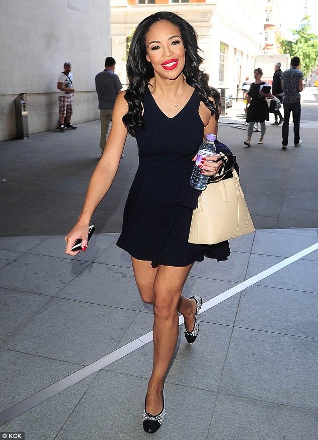 Little black dress: Sarah-Jane makes a glamorous arrival at London's BBC studios, where she serves as a 1xtra DJ, on Monday