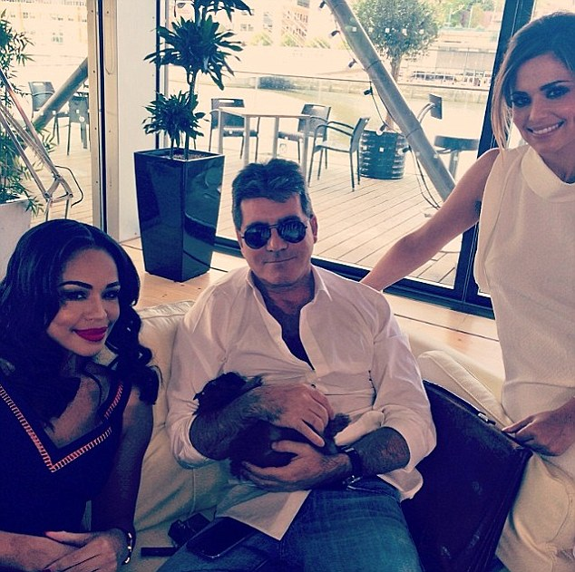 The new crew: Sarah-Jane poses with Simon Cowell and Cheryl Cole as they work on the X Factor