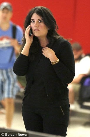 Monica Lewinsky looks tired as she arrives in Los Angeles.