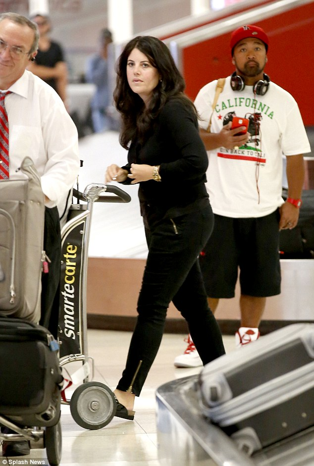 Sleek lines: Monika Lewinsky opted for an all-black ensemble as she jetted in to Los Angeles airport